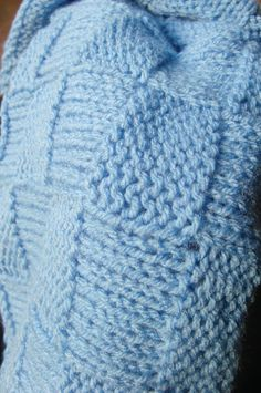 Hand knitted baby blanket. Blue.  Fully machine washable and tumble dry!