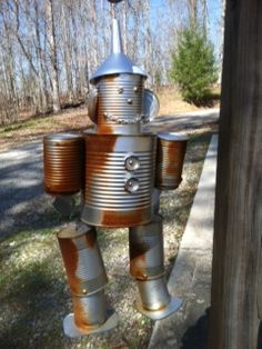tin man from leftover cans and funnel;repurposing