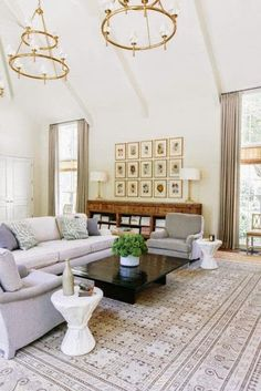 traditional white and gray living room;  like the grid of artwork