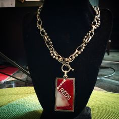 I offer sports pendants done in mosaic for those who love to cheer on their favorite teams.