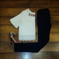 This top is a spring must have! The crocheted trim is beautiful! Add some fun heels and jewelry for a pop of color!