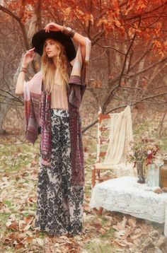 mix of patterns, drapey fabrics, the hat. Boho inspired outfit