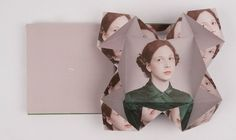 The photo-based artist's altered portrait series comes to 3D book form, origami included