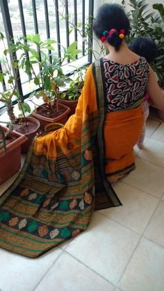 Pompoms in hair while i pass my time in my small garden... South cotton saree with a kalamkari blouse