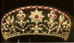 Ruby and diamond tiara of Princess Ashraf Pahlavi of Iran, sister of the Shah. The tiara features star and crescent motifs, and a heart shaped ruby in the central medallion.