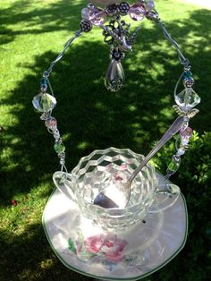 """I've been busy ;)  """"Vintage Sugar Bowl""""  New bird feeder, vintage sugar bowl & silver spoon sits on pretty china saucer, with Lots of extra charms and matching beads.  Gift card & organic bird seed included with all feeders.   $32 + shipping :)  SOLD... Thank you :)"""
