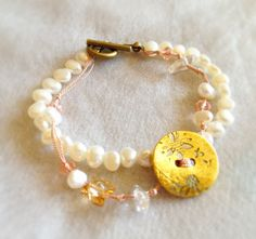 my work: shell button with Japanese traditional gold leaf & pearl bracelet *photo by afs