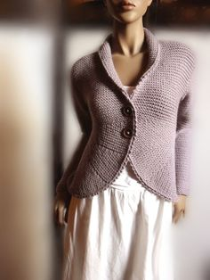 Handknit Jacket Sweater with rounded edges long sleeves and wooden buttons.  I have this sweater in a pink cotton. Now want to find the pattern!