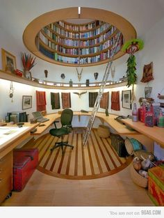 This, this, THIS! A workspace with a library above it and countertops all around, could anything be more glorious? (Study of Wade Davis, National Geographic Explorer in Residence)