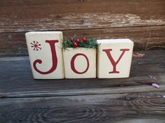 These blocks are sure to bring JOY to your home at the holidays! There are 3 wooden blocks, 3 with Joy in red vinyl letters. The blocks are painted and sanded for a rustic touch. Holiday greenery with red berries is added on the o for a cute look Easy Christmas Decorations, Christmas Wood Crafts, Christmas Projects, Holiday Crafts, Christmas Crafts, Christmas Ornaments, Holiday Decor, Christmas Ideas, Rustic Christmas