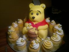 Winnie pooh cake and cupcakes