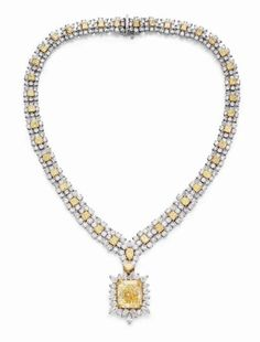 rectangular-cut fancy yellow diamond, weighing approximately 30.06 ct
