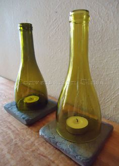 Made from actual wine bottles, these candle holders are perfect for any party, wedding reception, or wine bar - wherever you want a warm, romantic glow. The earth tone glass tops pair perfectly with the rustic slate bases - simple elegance! PLEASE NOTE: We notch the bottom edge of each hurricane lamp (see last picture) to allow airflow to circulate; something other sellers dont do. But without this notch, a real candle would snuff out - the candles need oxygen to circulate! Why limit…