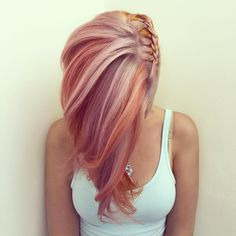 Side French braid on peachy pink hair