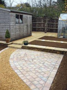 Patio stones plus loose stones to make a simple patio.
