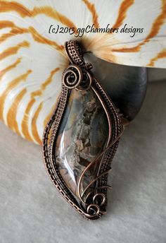 Antiqued copper pendant featuring a Butterfly Jasper cabochon.