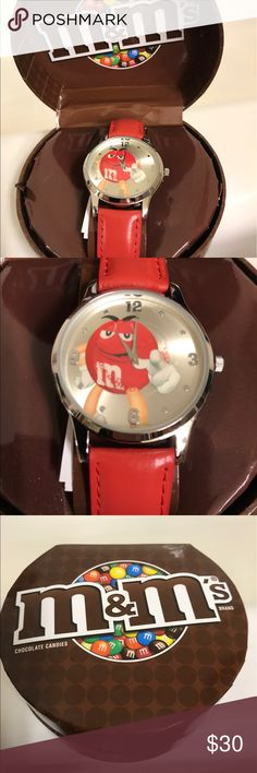 NIB AVON Red M&M Leather band watch. AVON Collectible NIB leather band women's M&M watch featuring the Red character. In collectible box, with the watch static cling still covering the face. A must for any collector! Avon Accessories Watches