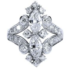 A 1940s ring with near colorless and VS1+ quality diamonds of ~4.40 carats total weight.