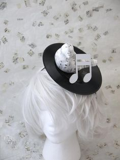 This hand made piece includes a recycled record to complete the music look.    Other listings with other accents or popular single tracks are available