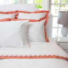 THE LINDEN CORAL BORDER The luxury is in the details, especially when inspired by the classic bedding found in the finest luxury hotels around the world. Woven from luxurious 400-thread count, single ply, 100% cotton with tailored coral borders, this irresistibly soft and beautiful duvet lends elegance to any room.