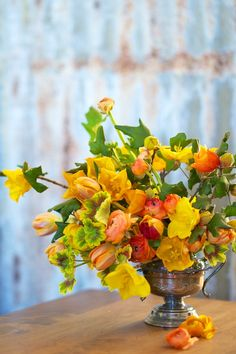 Garden-style arrangement with tulips, geraniums & ranunculus