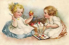 sweet little toddlers painting eggs.