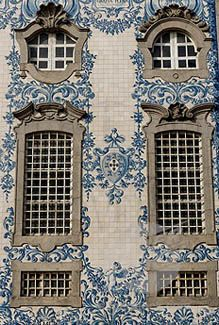 AZULEJOS TILES	  THE AZULEJOS TILE WALL RELIEF IS FOUND THROUGHOUT PORTUGAL.  THESE RELIEFS HAVE BEEN TELLING THE STORY OF THE PORTUGUESE PEOPLE SINCE CENTURIES. TYPICALLY THEY ARE HAND PAINTED IN BLUE AND WHITE, BUT OFTEN YOU MAY SEE THESE TILES IN VERY RICH AND FRIENDLY COLORS.