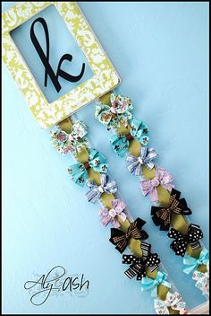 Monogram Bow Holder....cute way to organize all those hair accessories