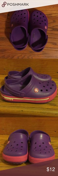 Girls purple/pink Crocs. My daughter only wore this a couple of times. They are still in great condition. CROCS Shoes Sandals & Flip Flops