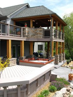 Love this exterior! Thinking about adding stone to deck beams, adding on to screened porch and ground-level decking.