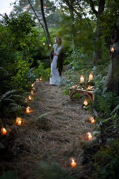 backyard wedding. - This actually kind of reminds me of the garden path from the parking lot to the restaurant at the McMenamin's in Beaverton, OR. I fell in love with that place when I saw the grounds! It was quite amazing and very beautiful at nigh t when everything was lit up. Candle lit path for back yard wedding