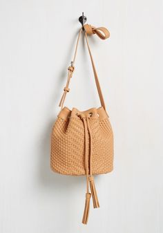 Head, Shoulders, Knees, and Totes Bag. From top to bottom, your ensemble is on point - including and especially this tan bucket bag! #tan #modcloth