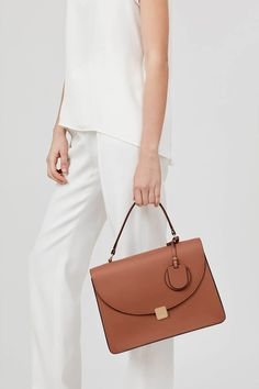 78fd46c6eae2e Our structured top-handle bag delivers a polished sensibility for every