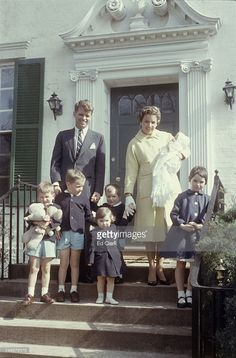 Family portrait of American politician Robert Kennedy (1925 - 1968), his wife Ethel Kennedy (nee Skakel), and their children, as they stand on the steps outside their home, McLean, Virginia, March 1958. Pictured are, Robert Kennedy and Ethel Kennedy, who holds infant Michael (1958 - 1997), and, the children from left, Kathleen (later Kathleen Kennedy Townsend), Joseph II, Courtney (later Courtney Kennedy Hill), Robert Jr, and David (1955 - 1984).