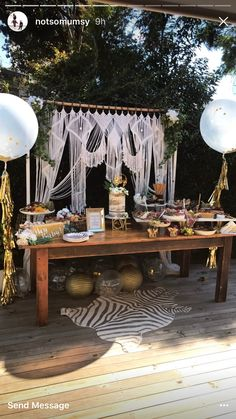 Grazing table bohemian style baby shower. Confetti filled balloons DIYStyle.com.au