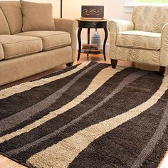 The hand-woven shag rug is sure to stand out in a modern or classic room with its colors of dark brown and cream. This rug features a brown background with ribbons of the lighter shade for more stylish design. The rug is eight foot by ten foot.