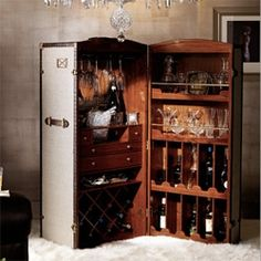 Anniversary gift ideas - a steamer trunk travel bar stocked with Waterford crystal.
