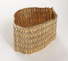 Armband, 18 K GG und RG, ornamentiert, Sicherungskettchen, L = 19 cm, ca. 122,2 g