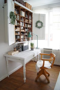 White shabby chic and old oak...such a warm and comfortable combination. Makes me want to sink right in and start writing.