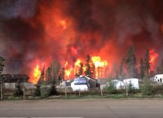 Fort McMurray fire: most of Canadian city evacuated as blaze engulfs homes…
