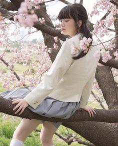 Cute school girl on Sakura tree 🌸