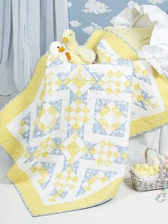 """Sunny Lanes - pieced block-and-star units form bright, patterned pathways. This e-pattern was originally published in Easy Four-Patch Quilting.  Size: 47"""" x 59"""". Block Size: 12"""" x 12""""."""
