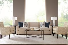 A pair of Boyd chairs and a Brynne sofa sure help pull together this crisp living space!