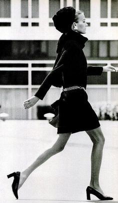 1967 Mary Russell wears Yves Saint Laurent's hit tunic outfit of black wool jersey, worn with knitted cap and scarf, photo by Pierre Boulat, Paris,