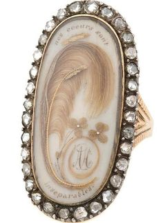 Ring with a lock of hair, and embroidery, which says, Our hearts are inseparable