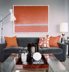 gray and orange living room --- I'm so excited to paint the walls this weekend and get pictures hung!
