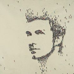 If you look really closely, you will see that this picture is made up of hundreds of people or human shapes, carefully placed to produce a picture of the artist aged 30.  The artist is called Craig Alan who was born in California, USA.  His work shows clever use of perspective and imagination.