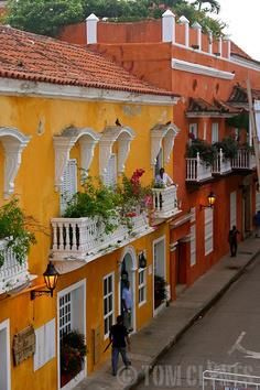 Vibrantly colorful houses line the streets of the Old Town in Cartagena, Colombia Places To Travel, Places To See, Colourful Buildings, Colorful Houses, Ecuador, Beautiful World, Beautiful Places, Travel Around The World, Around The Worlds
