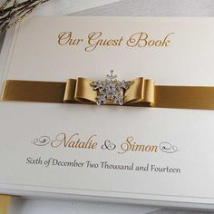 Exclusive luxury wedding guest books and gorgeous handmade wedding stationery handcrafted in the UK by Wedding Invitation Boutique. Established 2006.