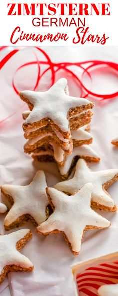 german christmas cookie Zimtsterne - Cinnamon Stars - a delicious blend of ground almonds and cinnamon topped with a sweet meringue glaze. Youre going to love this easy, delicious and traditional German Christmas Cookie. German Christmas Traditions, German Christmas Cookies, German Cookies, Holiday Cookies, Cookie Desserts, Cookie Recipes, Dessert Recipes, Christmas Cooking, Christmas Desserts